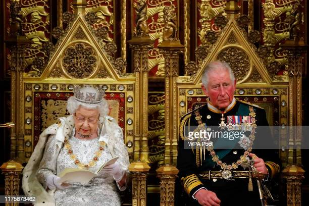 Britain's Queen Elizabeth II reads the Queen's Speech on the The Sovereign's Throne in the House of Lords next to Prince Charles, Prince of Wales...