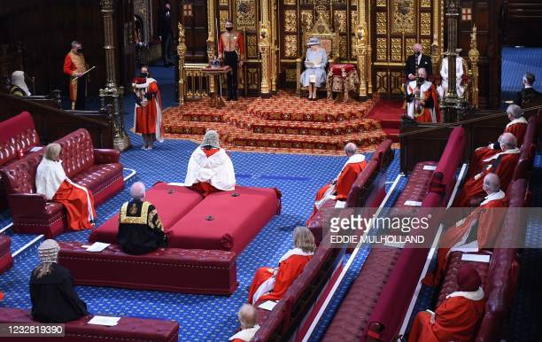 Britain's Queen Elizabeth II reads the Queen's Speech on the The Sovereign's Throne in the socially distanced House of Lords chamber, during the...