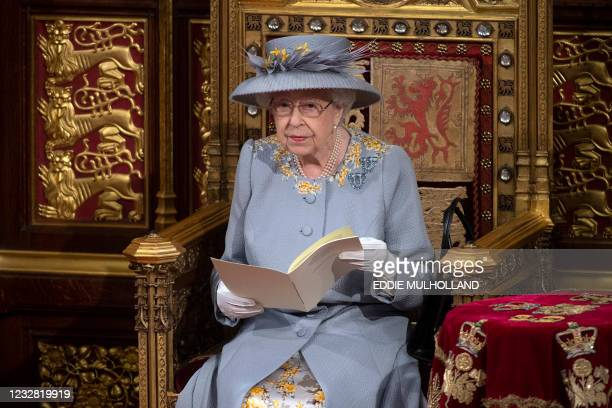 Britain's Queen Elizabeth II reads the Queen's Speech on the The Sovereign's Throne in the House of Lords chamber,, during the State Opening of...