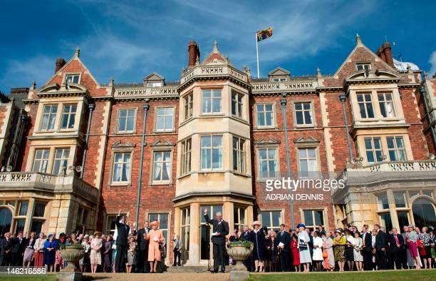 Britain's Queen Elizabeth II receives a round of applause from guests to conclude a garden party in honour of her diamond jubilee at the Queen's...