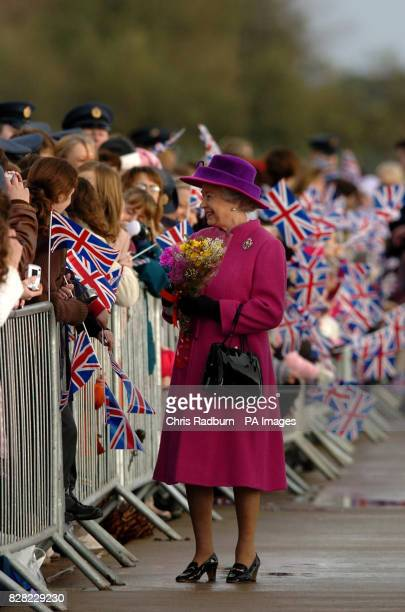 Britain's Queen Elizabeth II receives flowers and chats to families and serviceman at RAF Coltishall, Thursday November 17 2005, marking the 65th...