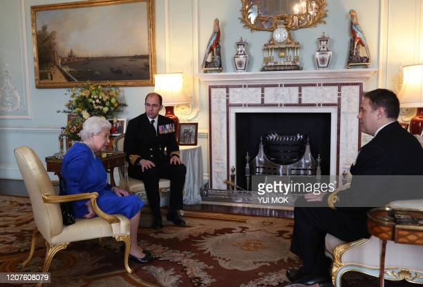 Britain's Queen Elizabeth II receives outgoing Commanding Officer, HMS Queen Elizabeth, Commodore Steven Moorhouse and incoming Commanding Officer,...