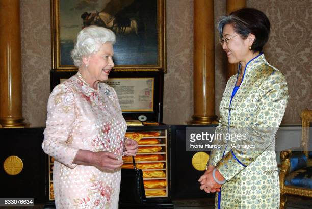 Britain's Queen Elizabeth II receives the Ambassador of China Mrs Fu Ying at Buckingham Palace London