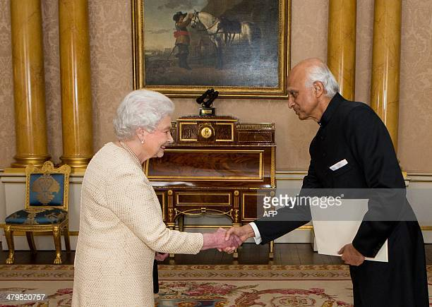 Britain's Queen Elizabeth II recieves High Commissioner for India Ranjan Mathai during a private audience as he presents his credentials at...