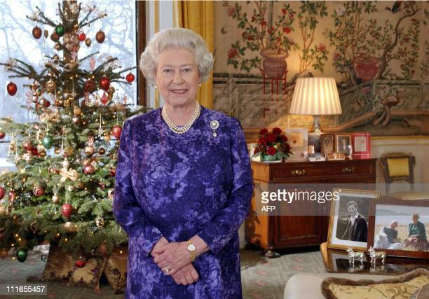 Britain's Queen Elizabeth II records her Christmas Day message in the Yellow Drawing Room at Buckingham Palace in London 15 December 2004