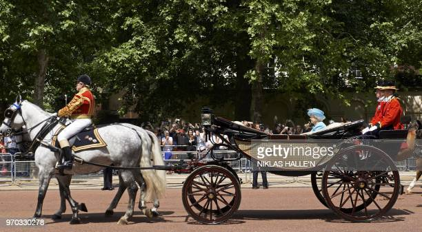 Britain's Queen Elizabeth II returns in a horsedrawn carriage after attending her Birthday Parade 'Trooping the Colour' on Horseguards parade in...