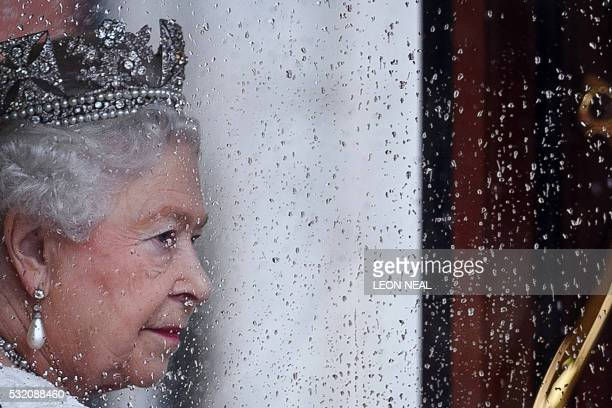 TOPSHOT Britain's Queen Elizabeth II returns to Buckingham Palace from the Houses of Parliament following the State Opening of Parliament in central...