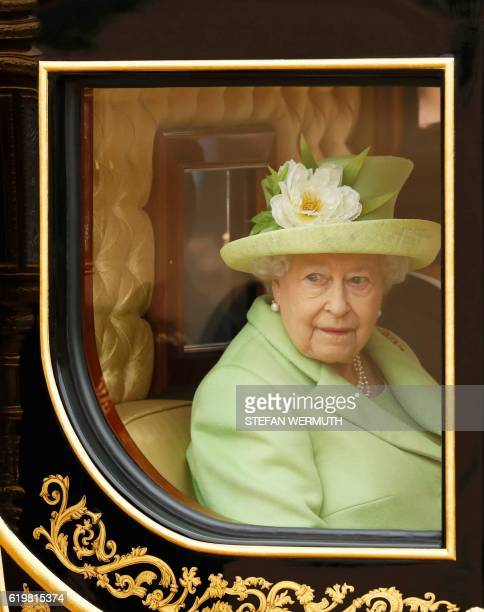 Britain's Queen Elizabeth II rides a carriage with Colombia's President Juan Manuel Santos after the ceremonial welcome at Horse Guards Parade in...