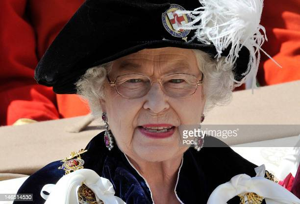 Britain's Queen Elizabeth II rides in a carriage after leaving St George's Chapel following the annual service of the Order of the Garter at Windsor...