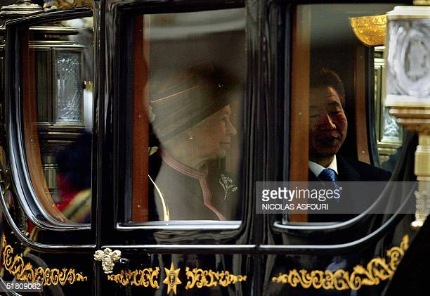 Britain's Queen Elizabeth II rides in a carridge with South Korean President Roh Moohyun on the Mall to Buckingham Palace in London 01 December 2004...
