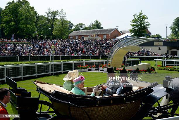 Britain's Queen Elizabeth II rides in the carriage with The Prince of Wales and The Duchess of Cornwall and Lord Dalmeny as they arrive at the...
