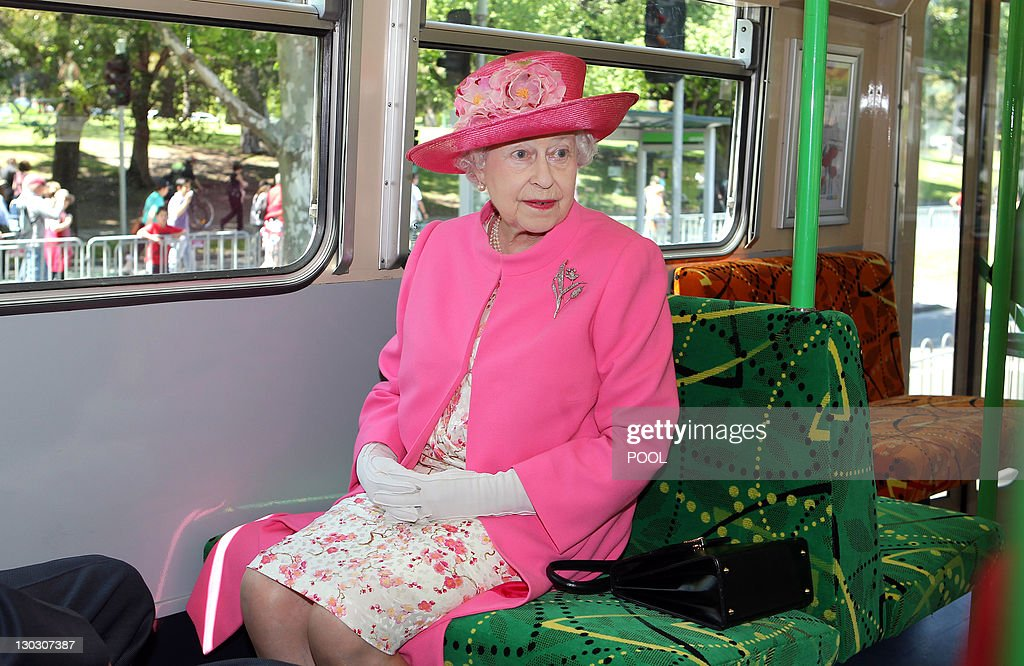Britain's Queen Elizabeth II rides on a tram during her visit to Melbourne on October 26, 2011. Britain's Queen Elizabeth II rode a royal-themed commemorative tram and met massive, adoring crowds as she walked a red carpet through Melbourne's Federation Square.
