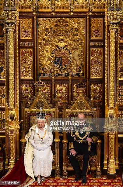 Britain's Queen Elizabeth II seated on the throne in the House of Lords next to Prince Philip Duke of Edinburgh delivers the Queen's Speech during...