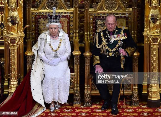 Britain's Queen Elizabeth II seated on the throne in the House of Lords next to Prince Philip Duke of Edinburgh waits to deliver the Queen's Speech...