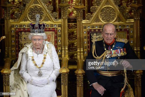 Britain's Queen Elizabeth II seated on the Throne in the House of Lords next to Prince Philip Duke of Edinburgh prepares to deliver the Queen's...