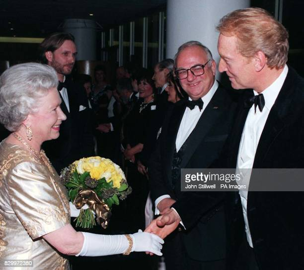 Britain's Queen Elizabeth II shakes hands with actor Charles Dance at the Royal Festival Hall after attending a Royal Gala Concert this evening to...