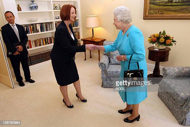 Britain's Queen Elizabeth II shakes hands with Australian Prime Minister Julia Gillard during their meeting at Government House in Canberra as part...