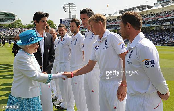 Britain's Queen Elizabeth II shakes hands with England's Joe Root as she meets English and Australian cricketers on the first day of the second Ashes...