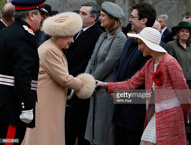 Britain's Queen Elizabeth II shakes hands with MarieFrance van Heel wife of Britain's Minister of Culture Media and Sport Andy Burnham as they attend...
