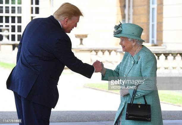 TOPSHOT Britain's Queen Elizabeth II shakes hands with US President Donald Trump during a welcome ceremony at Buckingham Palace in central London on...