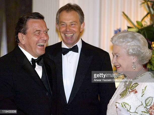 Britain's Queen Elizabeth II shares a joke with German Chancellor Gerhard Schroder and Britain's Prime Minister Tony Blair at Gleneagles Scotland...