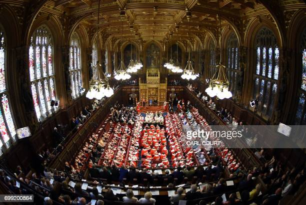Britain's Queen Elizabeth II sits alongside her son Britain's Prince Charles Prince of Wales as she delivers the Queen's Speech during the State...