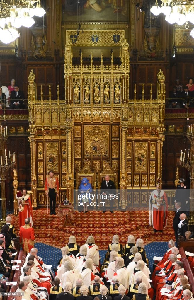 Britain's Queen Elizabeth II sits alongside her son Britain's Prince Charles, Prince of Wales as she delivers the Queen's Speech during the State Opening of Parliament in the Houses of Parliament in London on June 21, 2017. Queen Elizabeth II will formally open parliament and announce the British government's legislative programme on Wednesday, two days later than planned. The state opening, a ceremony full of pomp in which the monarch reads out the Queen's Speech detailing the government's programme for the coming year, was due to take place on June 19, but was delayed after Britain's Prime Minister Theresa May's Conservative party lost their majority in the House of Commons in the June 8 election. / AFP PHOTO / POOL / Carl Court