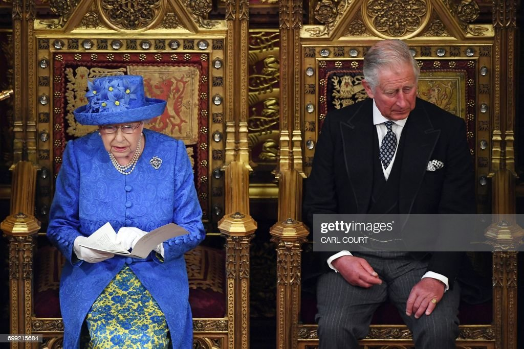 TOPSHOT - Britain's Queen Elizabeth II sits alongside her son Britain's Prince Charles, Prince of Wales as she delivers the Queen's Speech during the State Opening of Parliament in the Houses of Parliament in London on June 21, 2017. Queen Elizabeth II will formally open parliament and announce the British government's legislative programme on Wednesday, two days later than planned. The state opening, a ceremony full of pomp in which the monarch reads out the Queen's Speech detailing the government's programme for the coming year, was due to take place on June 19, but was delayed after Britain's Prime Minister Theresa May's Conservative party lost their majority in the House of Commons in the June 8 election. / AFP PHOTO / POOL / Carl Court
