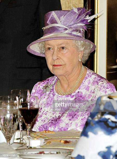 Britain's Queen Elizabeth II sits at her table for lunch during a visit to Government House on July 3 2010 in Winnipeg Canada The Queen and Duke of...