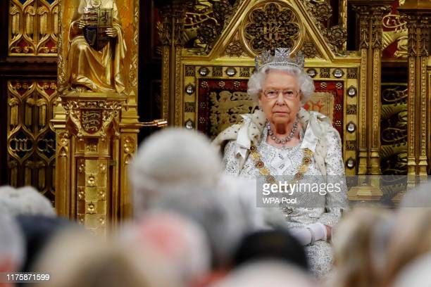 Britain's Queen Elizabeth II sits in The Sovereign's Throne in the House of Lords during the State Opening of Parliament in the Houses of Parliament...
