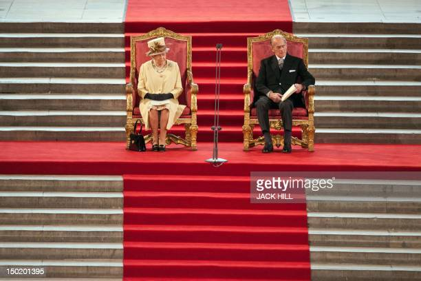 Britain's Queen Elizabeth II sits next to Prince Philip Duke of Edinburgh at Westminster Hall in London on March 20 2012 during a Loyal Address...