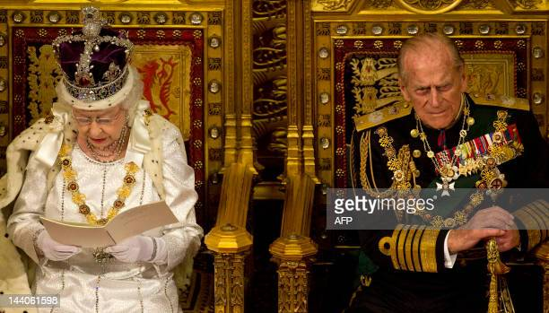 Britain's Queen Elizabeth II sits next to Prince Philip, Duke of Edinburgh , on the throne in the Chamber of the House of Lords as she reads the...