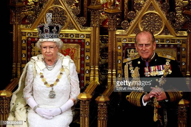 Britain's Queen Elizabeth II sits next to the Duke of Edinburgh at the House of Lords, in Westminster, in London, 06 November 2007, for the State...