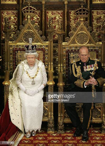 Britain's Queen Elizabeth II sits next to the Duke of Edinburgh at the House of Lords, in Westminster, in London, 06 November 2007, during the State...