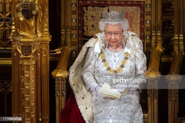 Britain's Queen Elizabeth II sits on the Sovereign's throne in the House of Lords as she delivers the Queen's Speech at the State Opening of...