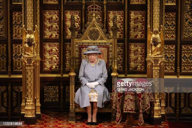 Britain's Queen Elizabeth II sits on the The Sovereign's Throne in the House of Lords chamber during the State Opening of Parliament at the Houses of...