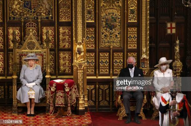Britain's Queen Elizabeth II sits on the The Sovereign's Throne in the House of Lords chamber, with Britain's Prince Charles, Prince of Wales and...