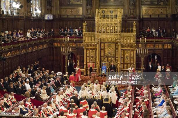 Britain's Queen Elizabeth II sits with her son Britain's Prince Charles Prince of Wales in the House of Lords during the State Opening of Parliament...