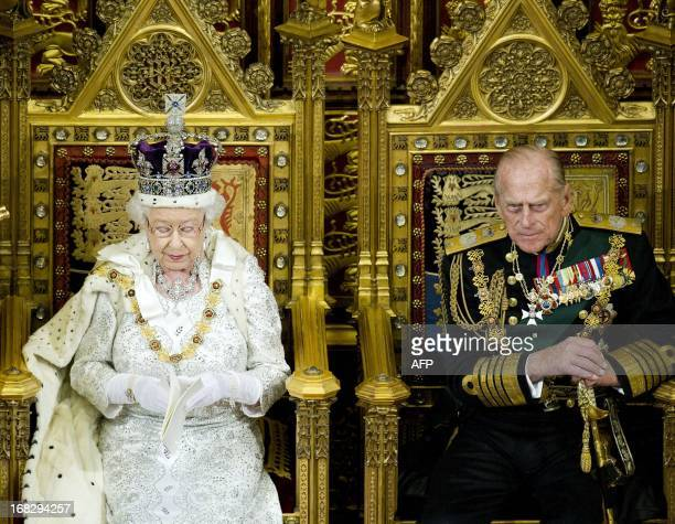 Britain's Queen Elizabeth II sits with Prince Philip, The Duke of Edinburgh as she delivers her speech in the House of Lords, during the State...