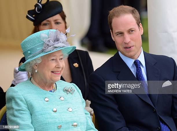 Britain's Queen Elizabeth II sits with Prince William during their visit to Vernon Park in Nottingham central England on June 13 2012 The Queen...