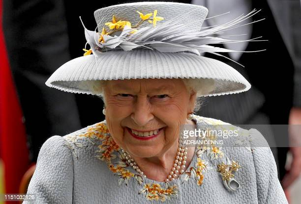 Britain's Queen Elizabeth II smiles as she attends day three of the Royal Ascot horse racing meet in Ascot west of London on June 20 2019 The fiveday...
