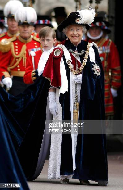 Britain's Queen Elizabeth II smiles as she attends the Most Noble Order of the Garter Ceremony at Windsor Castle in southern England June 15 2015 The...