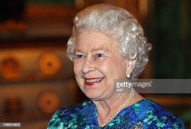 Britain's Queen Elizabeth II smiles as she is congratulated about her grandson Prince Williams' engagement to Kate Middleton during a reception for...