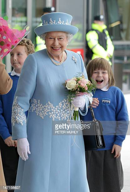Britain's Queen Elizabeth II smiles as she leaves after a visit to the South West Acute Hospital in Enniskillen Northern Ireland on June 26 2012...