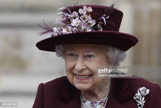 Britain's Queen Elizabeth II smiles as she leaves after attending a Commonwealth Day Service at Westminster Abbey in central London on March 12 2018...
