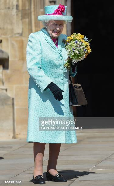 Britain's Queen Elizabeth II smiles as she leaves after attending the Easter Mattins Service at St. George's Chapel, Windsor Castle on April 21,...