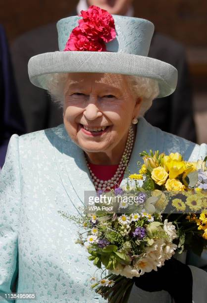 Britain's Queen Elizabeth II smiles as she leaves after attending the Easter Mattins Service at St George's Chapel on April 21 2019 in Windsor England