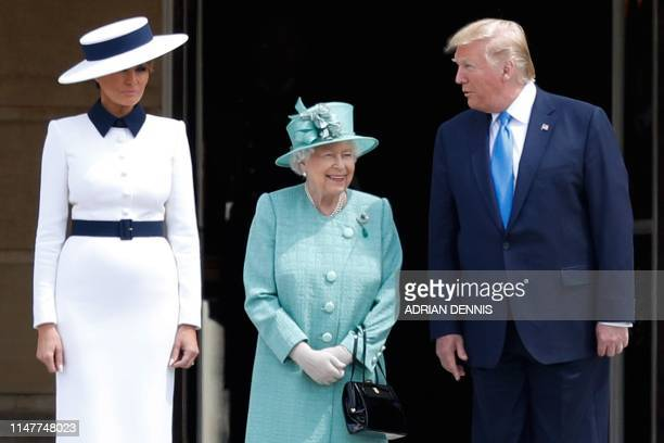 Britain's Queen Elizabeth II smiles as she speaks with US President Donald Trump as US First Lady Melania Trump stands by during a welcome ceremony...