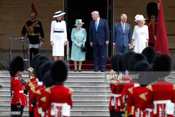 Britain's Queen Elizabeth II smiles as she speaks with US President Donald Trump as US First Lady Melania Trump stands by with Britain's Prince...