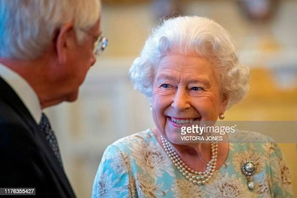 Britain's Queen Elizabeth II smiles as she talks with trustees and staff from The Queen's Trust during a reception in Buckingham Palace London on...